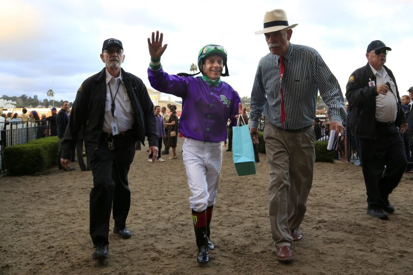 Jockey Victor Espinoza rode California Chrome all the way to the winners circle in the 8th race at the Del Mar Bing Crosby Season.