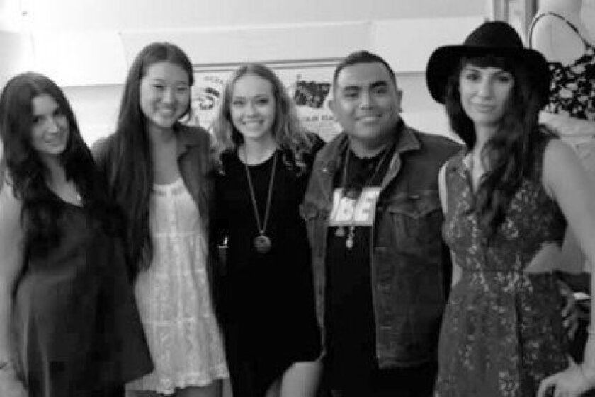 A photo taken just after the May, 2012 opening of the James Grant store on La Jolla Boulevard, with Andre Rene Briones (center) and Ilona Gregorievna (far left). Courtesy