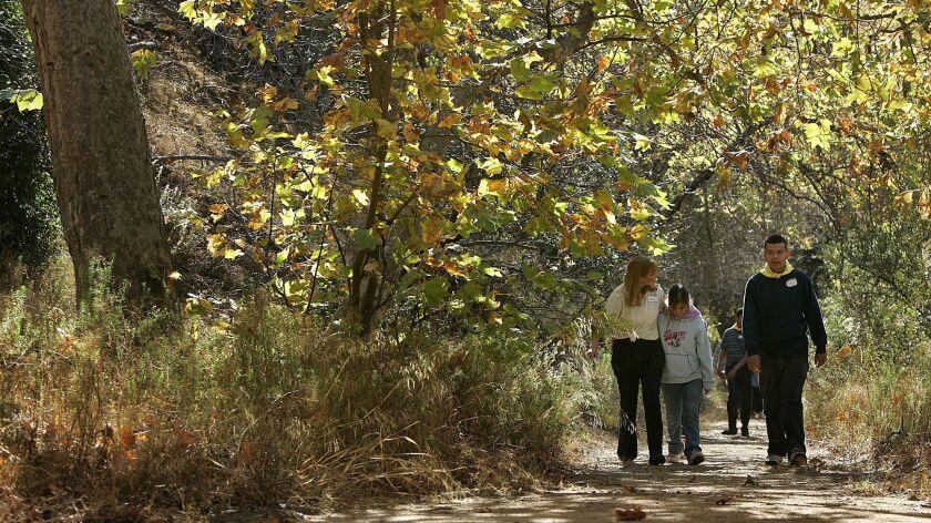 People walk along a trail in Malibu, Calif. on Dec. 8, 2006.