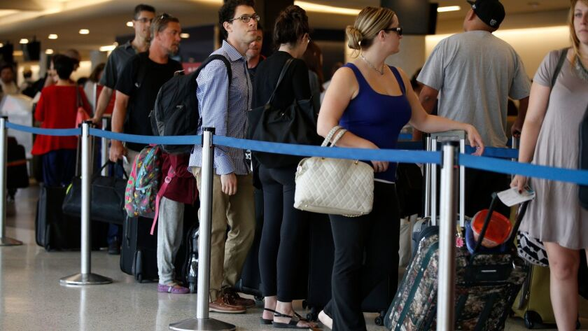 LOS ANGELES, SEPTEMBER 4, 2015: Travelers in Terminal 5 , wait in long lines at the Delta Airlines c