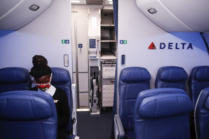 A Delta Air Lines employee wears personal protective equipment after landing in Minneapolis.