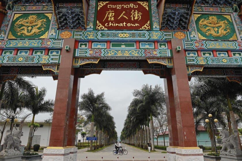 The gateway to Chinatown in a special economic zone in Ton Pheung, northwestern Laos. Most of the zone's 4,500 workers are Chinese.