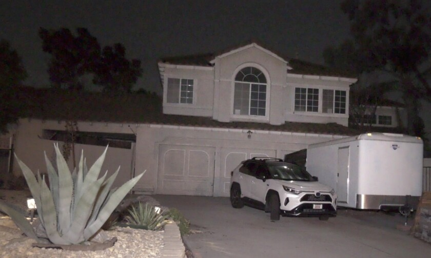 A house in Riverside with vehicles in driveway