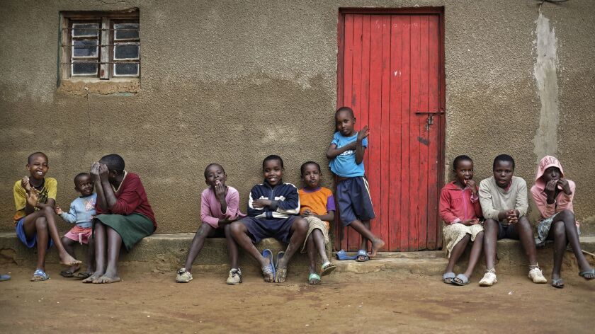 The children of genocide survivors and perpetrators play together Thursday in the reconciliation village of Mbyo, near Nyamata, in Rwanda.