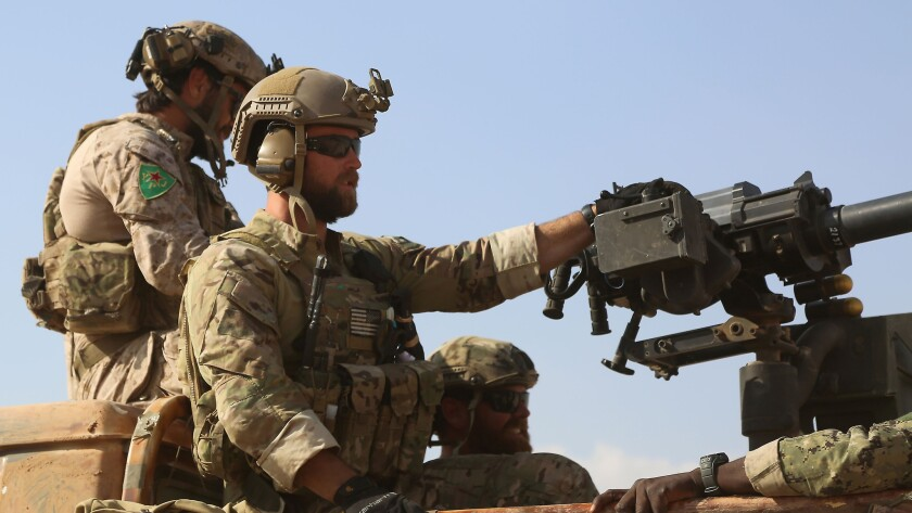 U.S. Special Forces operators ride in the back of a pickup truck in the northern Syrian village of Fatisah on May 25.