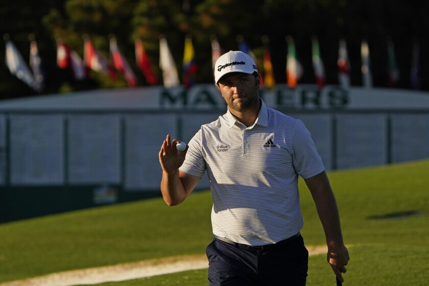 Jon Rahm, of Spain, holds his ball after a birdie on the ninth green during the second round of the Masters golf tournament Friday, Nov. 13, 2020, in Augusta, Ga. (AP Photo/Chris Carlson)