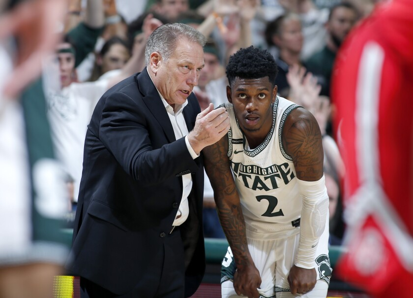 Michigan State coach Tom Izzo, left, talks with Rocket Watts during the second half of an NCAA college basketball game against Ohio State, Sunday, March 8, 2020, in East Lansing, Mich. (AP Photo/Al Goldis)