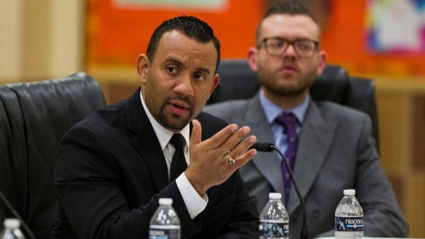 (In the foreground) Julio Fonseca, superintendent for the San Ysidro School District during a February board meeting