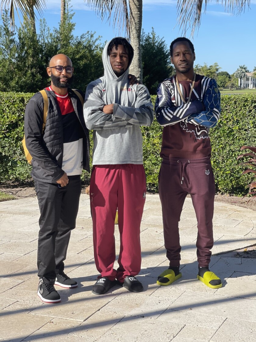 Uncle Terrell Samuel, left, with Asante Samuel Jr., center, and Asante Sr.