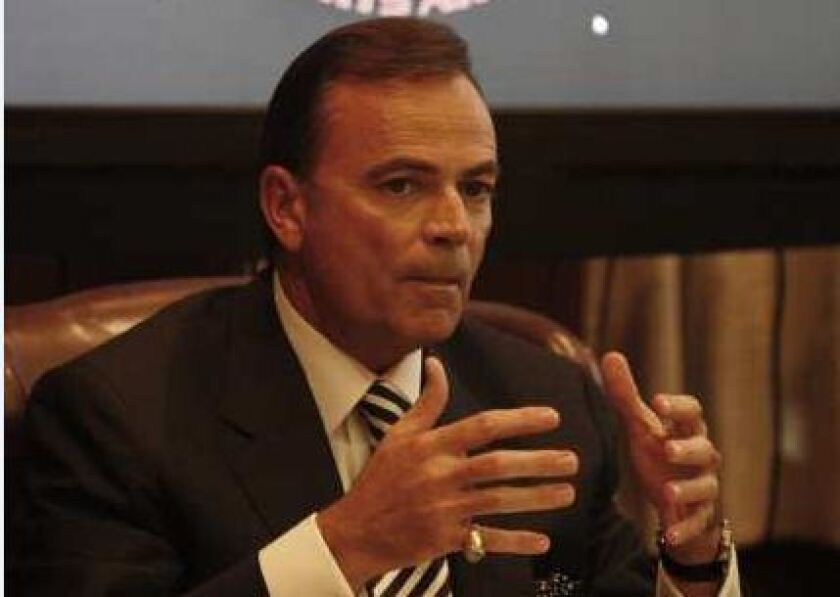 Commissioner Rick Caruso speaks at a meeting of the Los Angeles Memorial Coliseum Commission in December 2010.