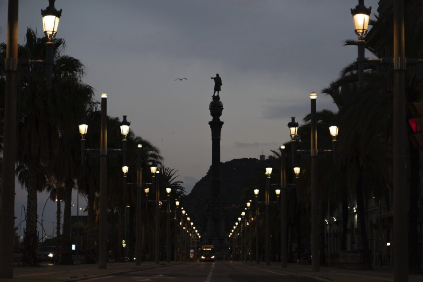 A seagull flies past the statue of Christopher Columbus in Barcelona, Spain, Thursday, July 2, 2020. Unlike in the United States, Britain and Belgium, statues of colonial-era figures have not become a major source of protests in Spain, which once ruled over one of the largest empires in history after conquering much of the Americas. Barcelona Mayor Ada Colau is one of the few public officials who say Spain must revisit its colonial legacy - though she is against timid calls to remove the city's monument to Christopher Columbus. Instead, she tells The Associated Press that she encourages a public discussion about the Italian explorer whose landing in the Caribbean in 1492 gave birth to Spain's overseas empire. (AP Photo/Renata Brito)