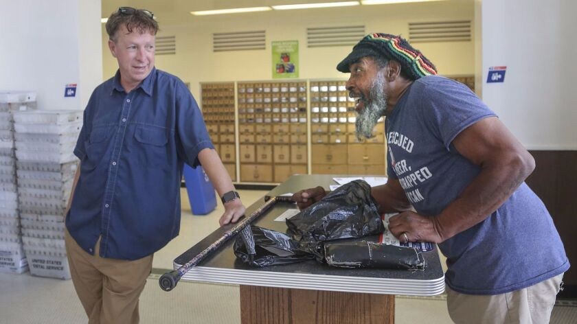 Former Chargers player Kenny Graham routinely hangs out at the Bakersfield post office, where he hop