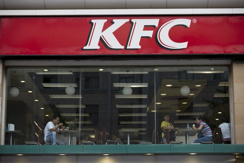One woman in Chengdu, China, spent an entire week at a KFC trying to get over a bad breakup. Pictured is a KFC in Beijing.