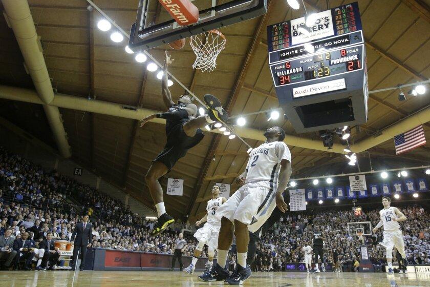 Providence's Kris Dunn shoots against Villanova's Kris Jenkins during the first half of an NCAA college basketball game, Tuesday, Feb. 24, 2015, in Villanova, Pa. (AP Photo/Matt Slocum)