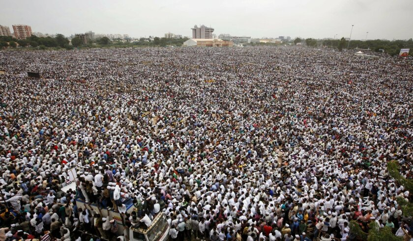 Tens of thousands of protestors from Gujarat's Patel community participate in a rally in Ahmadabad, India, Tuesday, Aug. 25, 2015. The members of the community from this western Indian state are demanding affirmative action for better access to education and employment. (AP Photo/Ajit Solanki)