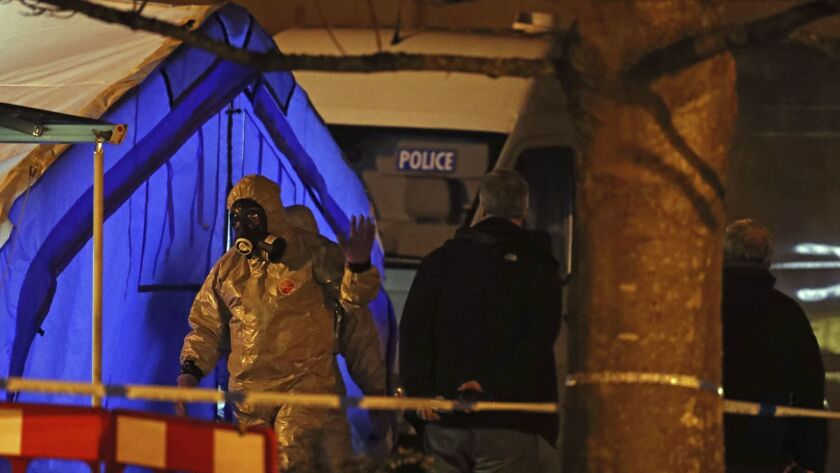 Investigators set up a police tent on March 6, 2018, in Salisbury, England, near where former Russian spy Sergei Skripal was found critically ill.