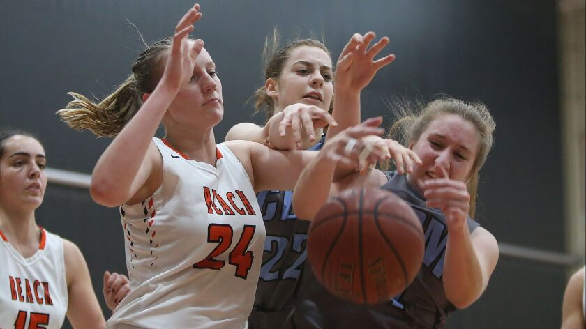 Corona del Mar's Tori Gyselaar, right, and Huntington's Andie Payne (24) contest a rebound during Su