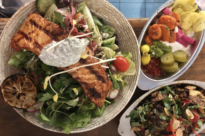 Grilled salmon salad and other dishes at Mizlala.