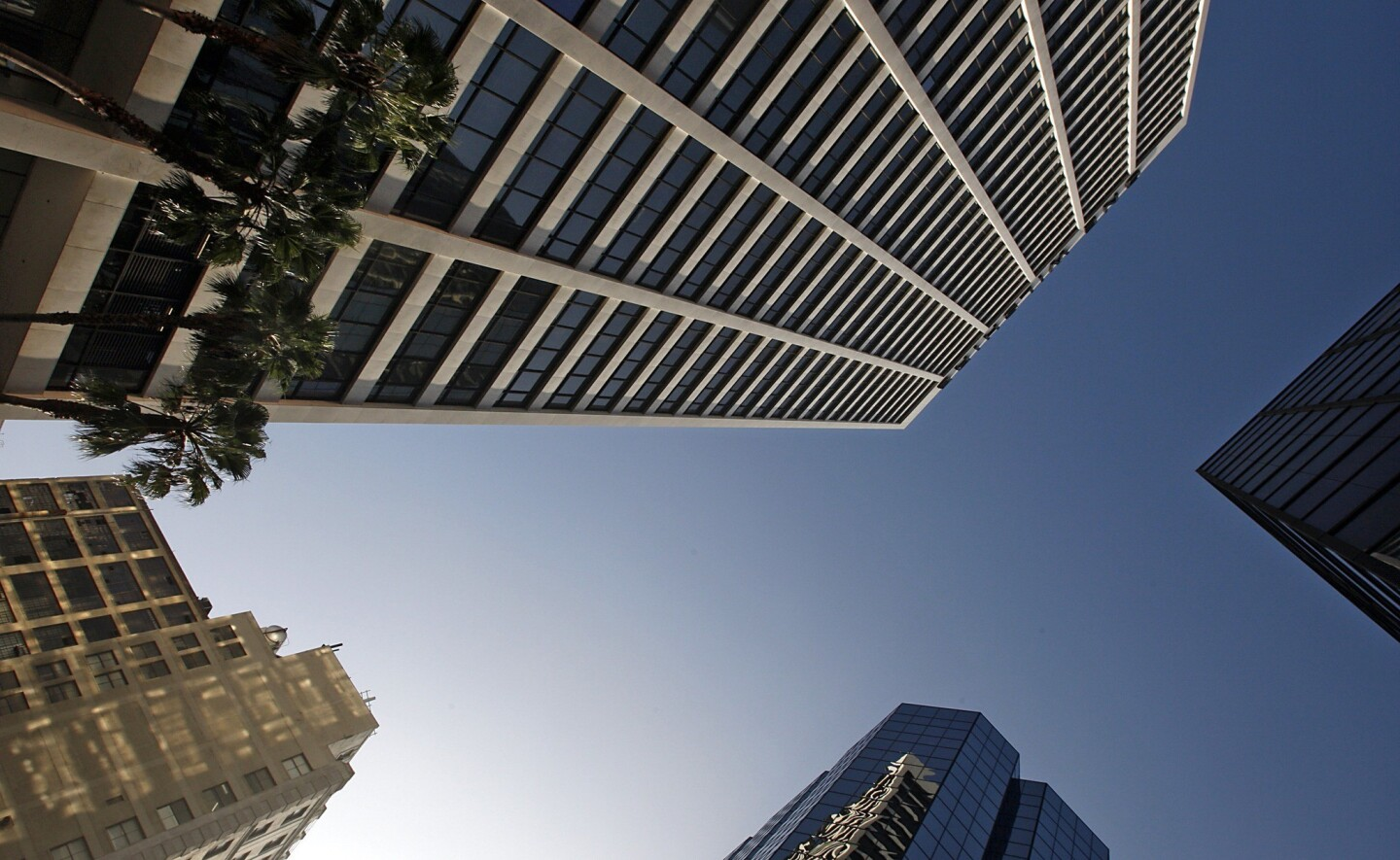 """One Wilshire, shown at top, at the eastern end of Wilshire Boulevard may look like a typical office building, but it's actually what's known as a """"telecom hotel,"""" holding servers, routers and other equipment for telecommunications companies, Internet service providers and other digital firms."""