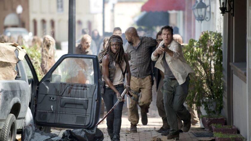 Danai Gurira as Michonne, Kenric Green as Scott and Jay Huguley as David - The Walking Dead _ Season