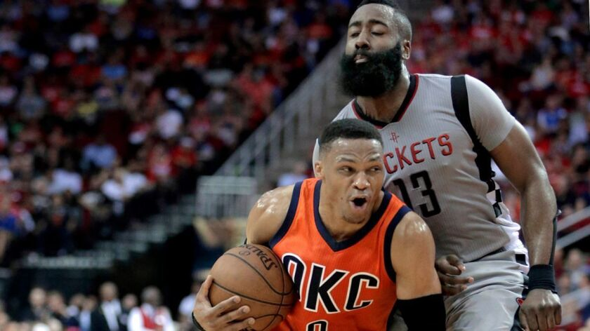 Oklahoma City Thunder's Russell Westbrook (0) is fouled as he drives around Houston Rocket' James Ha