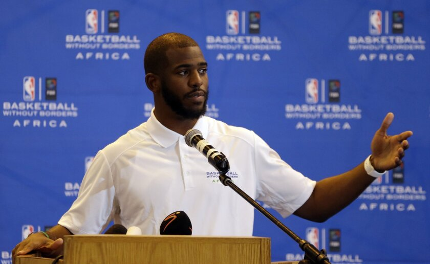NBA star Chris Paul speaks during a news conference at the American International School in Johannesburg, South Africa.