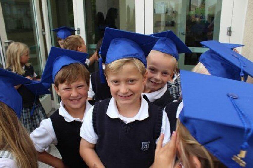 Kindergarten graduates Will Schreckengaust, Jack Scafidi and Roco Quaid