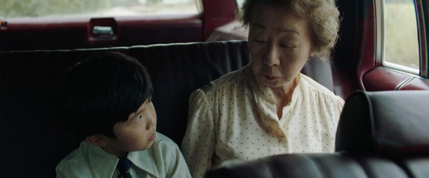 "Alan Kim and Yuh-Jung Youn in ""Minari."""