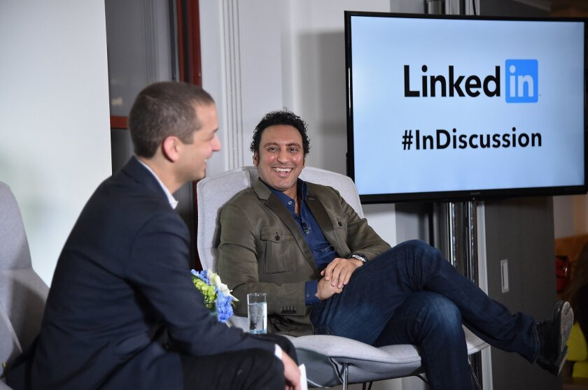 Dan Roth, LinkedIn executive editor, talks with actor and comic Aasif Mandvi at a LinkedIn discussion series in New York on March 31.