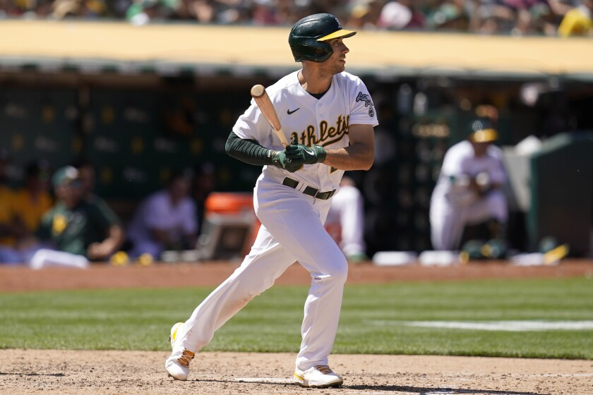 Oakland Athletics' Matt Olson watches his RBI single against the Los Angeles Angels during the seventh inning of a baseball game in Oakland, Calif., Tuesday, July 20, 2021. (AP Photo/Jeff Chiu)