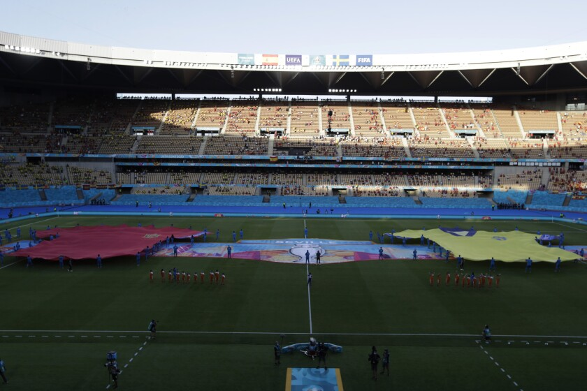Giant jersey are displayed on the pitch before the Euro 2020 soccer championship group E soccer match between Spain and Sweden, at La Cartuja stadium in Seville, Spain, Monday, June 14, 2021. (Julio Munoz/Pool via AP)