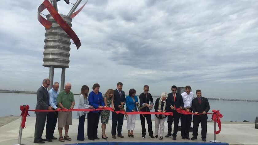 """Local elected officials and community leaders celebrate the installation of Michael Leaf's """"Powering the Arts"""" sculpture in September 2015."""