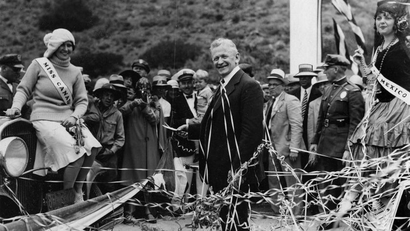 June 29, 1929: California Gov. C.C. Young, center, prepares to cut ribbons opening the Roosevelt Highway through Malibu.