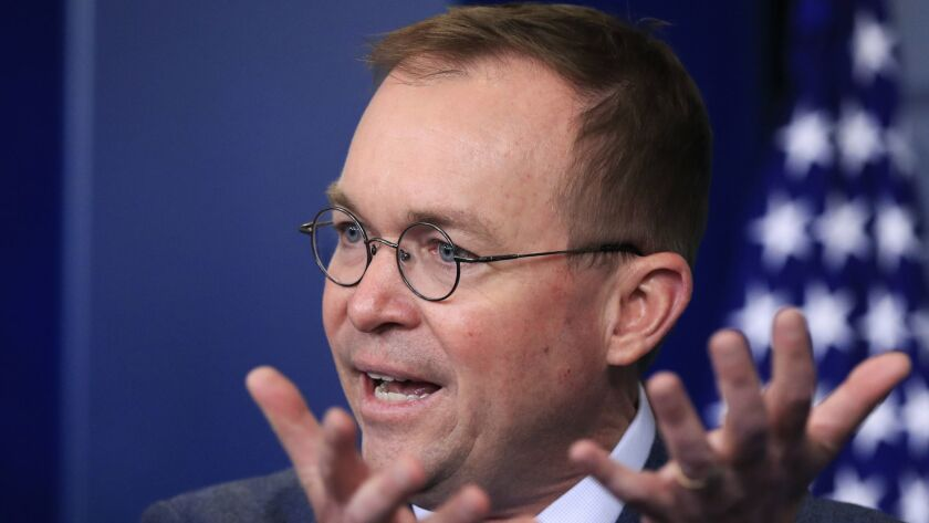 Mick Mulvaney, the acting director of the Consumer Financial Protection Bureau, speaks at a White House news briefing on March 22.