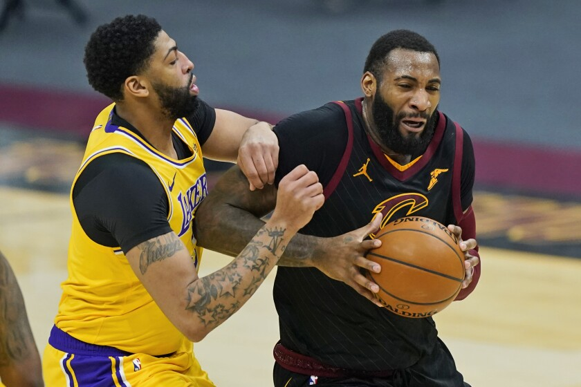 Andre Drummond drives against Anthony Davis during a Cavaliers-Lakers game.