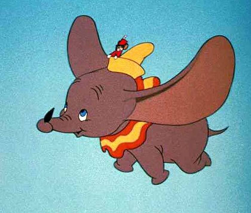 Timothy Q. Mouse rides in Dumbo's hat as the elephant flies
