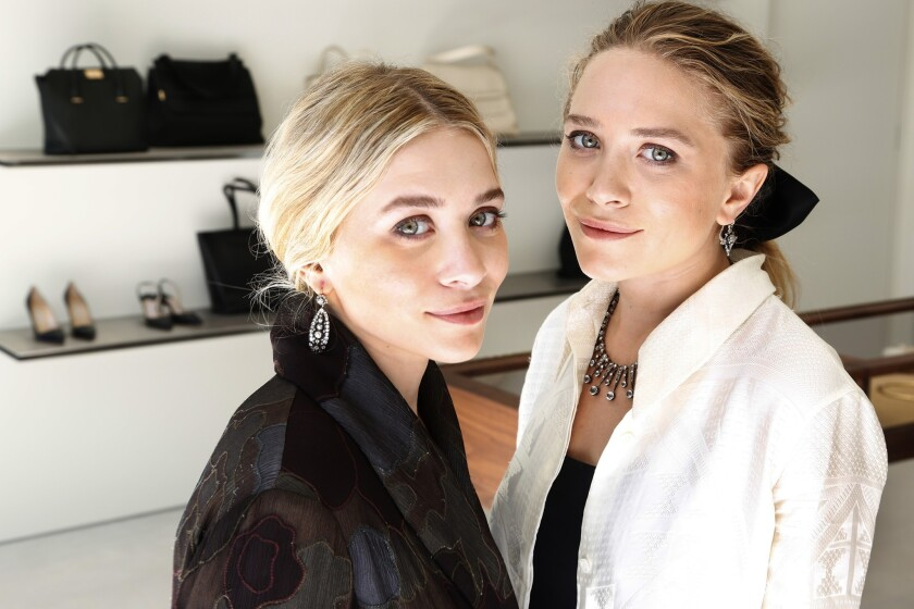 Sisters Ashley Olsen, left, and Mary-Kate at the opening of their first store for their fashion line, the Row.