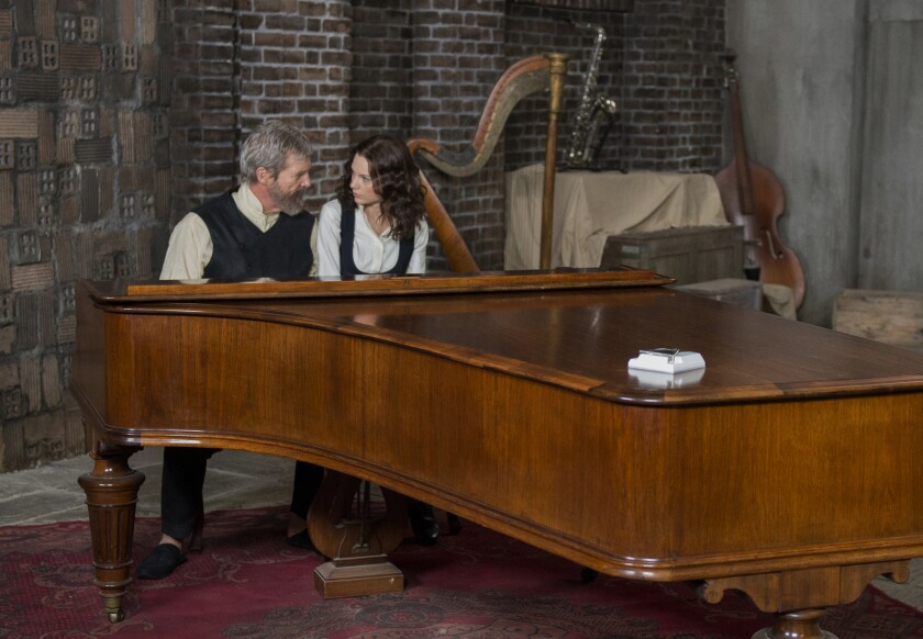 Jeff Bridges and Taylor Swift sit at a grand piano.