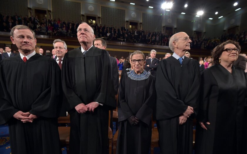 From left, Chief Justice John G. Roberts and Supreme Court justices Anthony M. Kennedy, Ruth Bader Ginsburg, Stephen G. Breyer and Sonia Sotomayor stand before President Barack Obama's State Of The Union address on Jan. 20 in Washington.