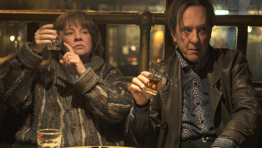 This image released by Fox Searchlight Pictures shows Melissa McCarthy and Richard E. Grant in a sce