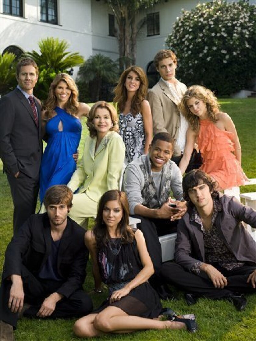 "In this image released by The CW network, the cast from ""90210"", front row from left, Ryan Eggold as Ryan, Jessica Stroup as Silver, Michael Steger as Navid; middle row from left, Jessica Walter as Tabitha, Tristan Wilds as Dixon, AnnaLynne McCord as Naomi; and back row from left, Rob Estes as Harry, Lori Loughlin as Debbie, Shenae Grimes as Annie and Dustin Milligan as Ethan, are shown. (AP Photo/The CW, Art Streiber)"