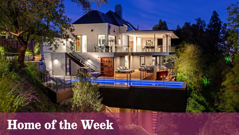 A cantilevered swimming pool is among new additions to this remade home in Bel-Air, which was previously owned by one family for more than half a century.