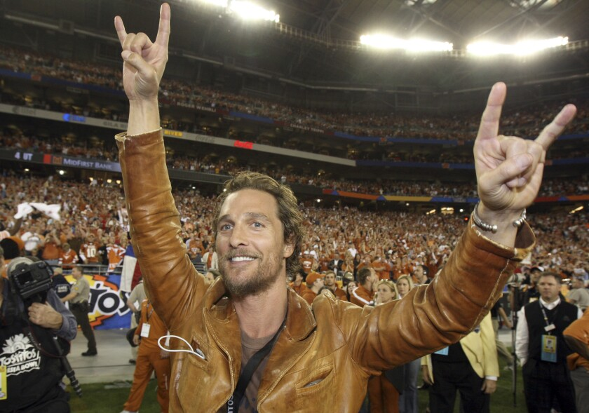Actor Matthew McConaughey celebrates after Texas defeated Ohio State in the Fiesta Bowl on Jan. 5, 2009. The University of Texas announced Thursday that McConaughey is teaching a filmmaking course at the school.
