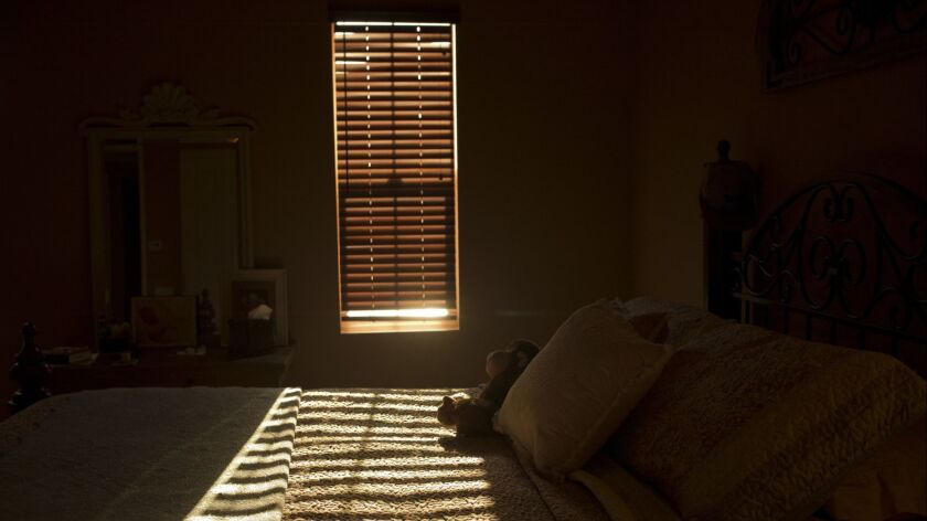 The late afternoon sunlight shines through the window of the room in La Quinta, Calif., Monday, Aug.