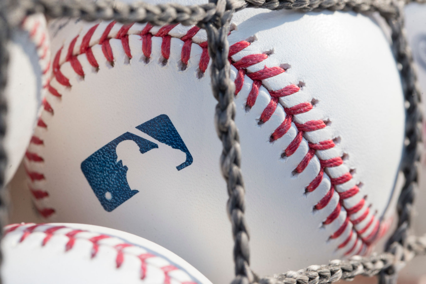 A closeup of a baseball with the MLB logo. Friday's game between the Cardinals and Brewers has been postponed.