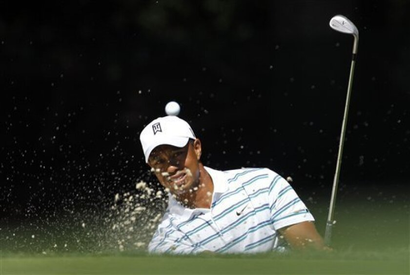 Tiger Woods hits out of a bunker on the 14th hole during the Pro-Am at the AT&T National golf tournament at the Aronimink Golf Club, Wednesday, June 30, 2010, in Newtown Square, Pa. (AP Photo/Matt Slocum)