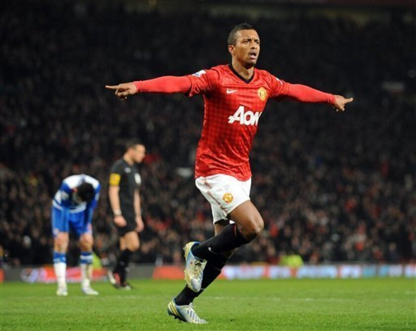 Manchester United's Nani celebrates after he scored the first goal of the game for his side during their English FA Cup fifth round soccer match against Reading at Old Trafford in Manchester, England, Monday Feb. 18, 2013. (AP Photo/Clint Hughes)