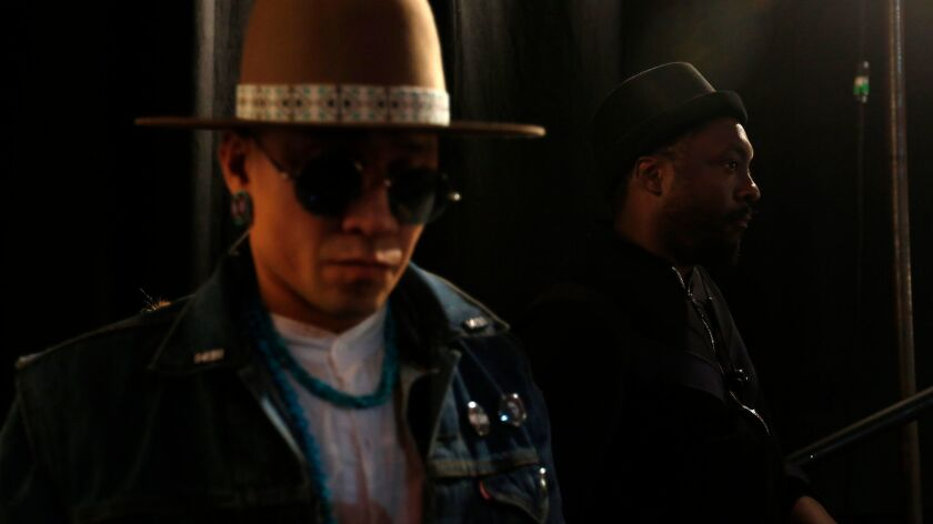 LOS ANGELES, CA - JANUARY 12, 2018 -- Taboo, left, and will.i.am, both of The Black Eyed Peas, wait