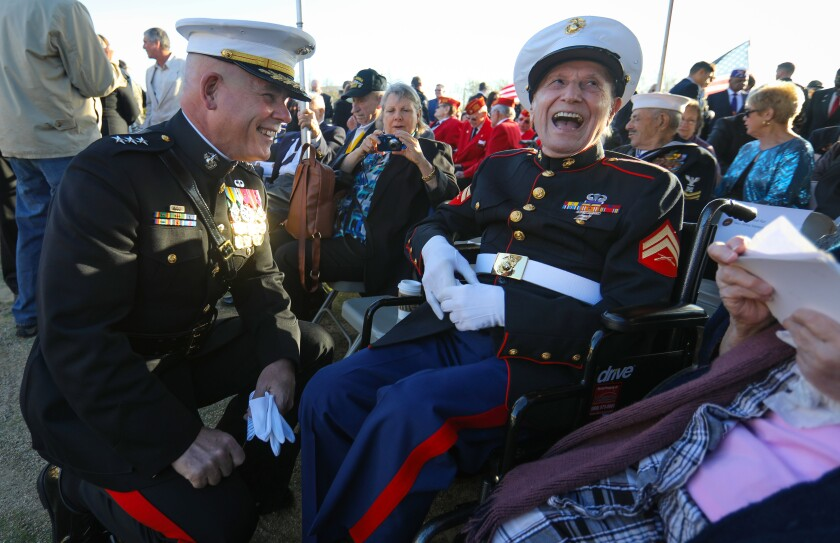 Marine Corps Lt. General Joseph Osterman, Commanding General of the the I Marine Expeditionary Force, left, and Samuel Prestigiacomo, right, of Newport Beach, who was a Marine in the Battle of Iwo Jima, enjoy a laugh before the commemoration of the 75th anniversary of the World War II Battle of Iwo Jima ceremony began at Camp Pendleton, February 15, 2020.
