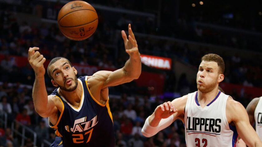 Utah Jazz center Rudy Gobert, left, reaches for a rebound in front of Clippers forward Blake Griffin